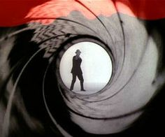 James Bond official theme song, The original theme is credited to Monty Norman, and was performed by John Barry and his orchestra in James Bond Titles, James Bond Movies, James Bond Goldfinger, Art Of The Title, James Bond Party, Bond Series, Shirley Bassey, Opening Credits, Internet Movies