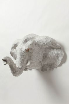 Anthropologie:  Layers of repurposed cement bags are covered with vintage French book pages to create this handmade, paper mache animal head.