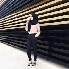 Pinterest: @eighthhorcruxx. Casual. Blush pink top, black hijab and trousers. Black vans