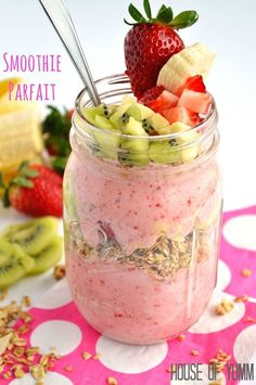Smoothie Parfait. Strawberry & Banana smoothie layered with granola and fresh fruit.
