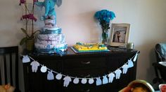 Baby shower: we had it after baby came so we all could meet him. I put fun facts on the baby garland, like birth weight and how the parents picked his name.