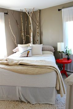 Birch tree branches in the corner...not sure how I feel about it... I like the pop of the bedside table though!