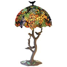 Features:  -2 Lights.  -Shade Material: Tiffany style glass.  -Indoor setting.  -458 Glass pieces.  -208 Cabochons.  -UL approved.  Base Color: -Brown.  Hardware Finish: -Antique bronze.  Fixture Mate