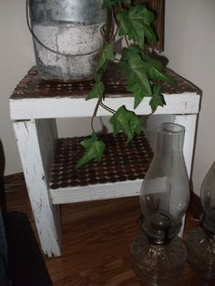 OLD SHABBY SIDE TABLE I RECYCLED BY ADDING PENNIES TO THE TOP AND THE SHELF....LOVE IT!