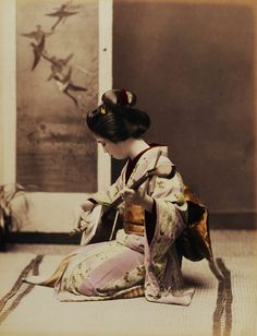 kx5991:  A geisha plays the shamisen c. 1880s