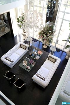 gorgeous home - Lisa Vanderpump's. The white tufted couches are to die for!