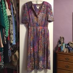 Vintage Floral Dress Vintage floral dress, style is extremely flattering. Runs true to size. I pair this dress with a purple cardigan with gold belt and pumps. Vintage Dresses
