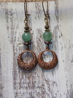 Beautiful brass texture hoops that have a swirl design are adorned with green aventurine gemstones and brass accents. Mini Kidney earwires in brass Measures 2 1/2 inches fr... #earrings
