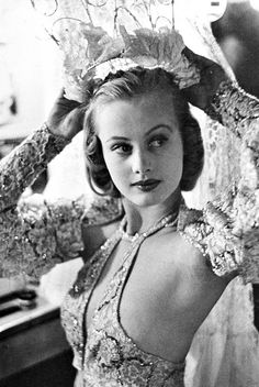 """Chorus girl, Hope Chandler, in the dressing room backstage at the Paradise cabaret restaurant in NYC 1937. Photo by Peter Stackpole. Photo was on the cover of LIFE  when she was 16 & named the """"Prettiest Girl in Paradise"""". David Whitmire Hearst, son of Wm R Hearst, saw the pic & promised that he would marry her before she was snatched up by another suitor. They married in 1938 and they remained together happily for 48 years until his death in 1986. Hope passed away in 2012."""