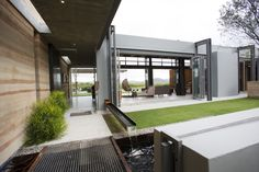 Sustainable home designed by Veld Architects. Making an Entrance. Connecting to the landscape. The materials, rammed earth, glass & steel, corten. Luxury Home.