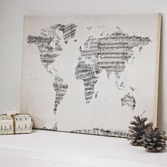 sheet-music-map-of-the-world-art-print absolutely love this. Could also work with pages of an old book.