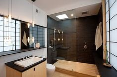 walk in shower with black tiles