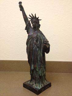 "One of the earliest bronzes of the Statue of Liberty 21 inches high signed Bartholdi, AP/150 ""artist proof"""