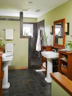 Ideas for the master bath, like the walk-in shower with the slate, looks good with the wood cabinetry.