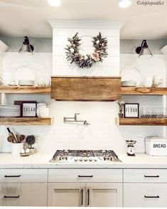 Haus Shiplap hood, whites and woods make for a beautiful farmhouse kitchen. For more farmhouse inspo Modern Farmhouse Kitchens, Farmhouse Kitchen Decor, Kitchen Redo, Home Decor Kitchen, New Kitchen, Home Kitchens, Shiplap In Kitchen, Kitchen Vent Hood, Kitchen Ideas