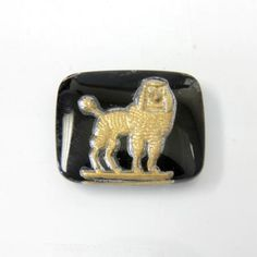 This glass intaglio jet and gold POODLE vintage stone is available in our discounted/clearance section. Once they're gone, they're gone! visit http://www.jfallen.com  #vintageglasscameo #vintagecameo #intaglio #poodlejewelry