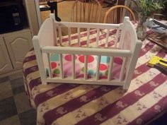 Here is a doll bed i made for my Niece