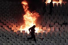 The Athens football derby between Panathinaikos and Olympiakos was abandoned after being interrupted twice by crowd violence on Sunday. REUTERS/Yorgos Karahalis