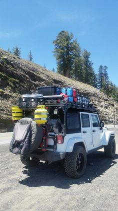 Look at all the stuff you can haul on the headframe! Jeep Wj, Jeep Rubicon, Jeep Cars, Jeep Wrangler Jk, Jeep Truck, Jeep Wrangler Unlimited, Jeep Wrangler Camping, Srt Jeep, Ford Trucks