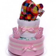 Elmer the elephant nappy cake gift with two tiers of nappies and cute flower designed socks, for a little baby girl gift. Little Baby Girl, Little Babies, Baby Girls, Baby Girl Cakes, Baby Girl Gifts, Elmer The Elephants, Colorful Elephant, Nappy Cakes, Gift Cake