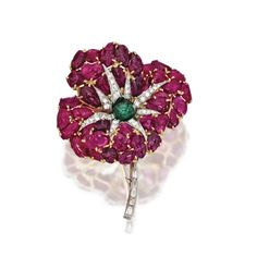 18 KARAT GOLD, PLATINUM, RUBY, EMERALD AND DIAMOND BROOCH, FRANCE, CIRCA 1945 Designed as a flower, the petals set with numerous carved rubies, set in the center with a cabochon emerald weighing approximately 1.00 carat, accented by numerous round and baguette diamonds weighing approximately 2.80 carats, French assay marks.
