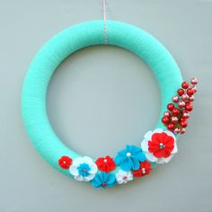 Yarn Wreath Turquoise.  Christmas Holiday wreath with Felt Flowers. Aqua, White and Red. 14 Inches. Featured in Cottages and Bungalows.. $44.00, via Etsy.