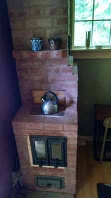 Recording studio masonry heater by Temple Fire