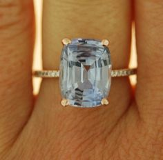 Sapphire engagement ring. Rose gold engagement ring. Eidelprecious ring. Gray sapphire ring. This Sapphire is natural untreated cushion cut stone. The cut is mesmerising, making the stone sparkle like crazy. The color is fantastic. It is light blue with silver/grey overtone. It changes constantly