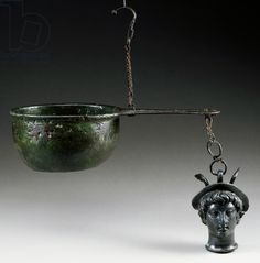 Bronze steelyard balance, patera with functioning plate, handle with hook for suspension and short chain at end with head of youthful Mercury wearing petasos, artifact uncovered in Pompeii, Campania, Italy, Roman Civilization, 1st century. Naples, Museo Archeologico Nazionale (Archaeological Museum)