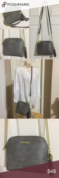 """Steve Madden BMarylin Dome Crossbody Purse Grey NEW WITH TAGS Authentic Steve Madden BMarylin Dome Crossbody Purse  • RETAIL $68.00 • Color: Gray (also available in Denim Blue) • Dimensions: 9""""W x 7.5""""H x 3.5""""D with 23"""" strap drop • Interior: 1 zipper compartment & 1 slip pocket • Top zip closure, Removable Tassel and Gold tone hardware  * Comes from a smoke free pet free environment  🎀 I have more STEVE MADDEN, Check out my other items!   ❤ LIKE ME ON FACEBOOK @MarianTNoonan Steve Madden…"""