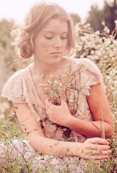 Pretty girl in a field of flowers