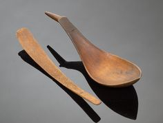 "Eskimo Spoons, 2004, American Indian Art Carved wooden spoon resembling a stylized bird, ""muk-mok"" written in bowl, length 8.5""; and one fossilized antler or bone spoon, length 7.75""."
