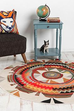Love this rug! I'll take the side table and chair too though ;)