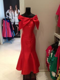 An amazing red dress that you can find at YOKKO The Fashion Store.