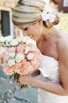 love her hair (color and highlights) with the flowers and the strapless top of her dress with the broach with stones