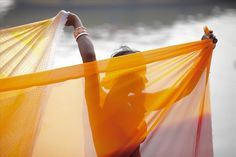 An indian woman dry her dress after taking a holy bath at Ganga river