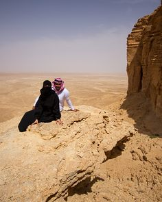 Couple in Saudi Dress on Cliff Ledge