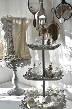 love the corset lamp shade and the vintage trays that would be some great ideas for my craft / studio!