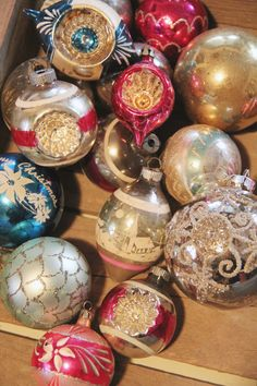 Vintage Christmas Ornaments. If it hasn't gotten broken, I have that center one with the house scene.