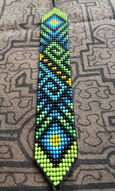 These sacred bead work bracelets are handmade by women from an indigenous cooper. These sacred bead work bracelets are handmade by women . Native Beading Patterns, Seed Bead Patterns, Loom Bracelet Patterns, Bead Loom Bracelets, Seed Bead Projects, Motifs Perler, Diy Couture, Beads And Wire, Bead Crochet