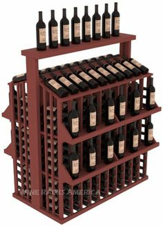 "Wooden 300 Bottle Single Reveal Aisle Wine Cellar Rack Storage Kit with Top in Pine with Cherry Stain + Satin Finish by Wine Racks America®. $907.90. 1 3/8"" Toe Kick Standard: We lift our racks up higher so your bottles are not sitting on the floor. Eco-friendly wood sources in sustainable forests. Some Assembly May Be Required. Choose From either Pine, Redwood, or Mahogany along with optional Industry Leading Quality Eco-Friendly Stains Paired with an Immacul..."
