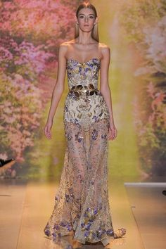 """: ZUHAIR MURAD HAUTE COUTURE S/S 2014  """"By one count, Zuhair Murad's wedding dress alone bloomed with upwards of 25,000 floral appliqués. The mystical garden segment of his collection overall contained a multitude of camellias, roses, peonies, gentian, and more, all shimmering atop gowns, jumpsuits, and cocktail frocks."""