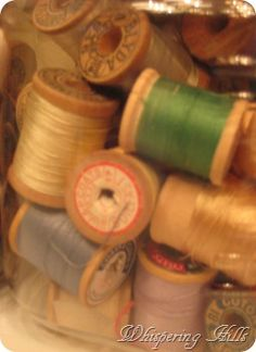 Old spools of thread~my grandma made all of her 'everyday' dresses. Her church dresses were birthday and Mothers day gifts from her family. She never once wore a pair of pants.