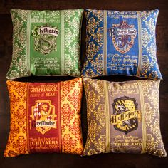 Set of 4 Harry Potter Pillows... Gryffindor Slytherin Ravenclaw Hufflepuff... all Hogwarts House Crests!