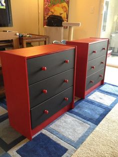 Ikea Rast kid sized dressers, painted red with chalkboard paint on the faces of the drawers for labeling, or doodling.