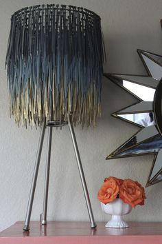 Kinda-sorta, but not really, tutorial on how to make this lampshade out of zip ties. I think it looks pretty cool and I would give it a shot. I think I would use all metallic spray paint colors though.