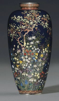 A Cloisonné Vase Mark of the Hayashi Kodenji Workshop, Meiji Period (late 19th century) Worked in various thicknesses of silver wire and coloured cloisonné enamels on a dark blue ground with a maple tree surrounded by a profusion of flowers including chrysanthemums, irises, wild pinks and grasses, the foot with floral lappets, the neck with a band of geometric pattern, silver rims 21cm. high. Christies 2012 - $42,000.