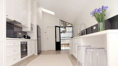 In this kitchen Dulux Whisper White was chosen to add warmth to this house, which does not receive much natural light.