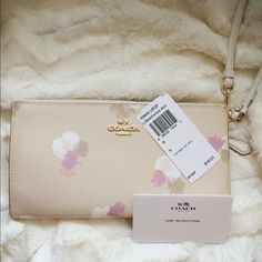 Coach Floral Print zip wallet BRAND NEW with tags 100% Guaranteed Authentic COACH Floral Print Zip Wallet in Light Gold/Beechwood. Stunning for the upcoming Spring/Summer Seasons, with a vintage-inspired floral print and a slim, soft-sided design that unzips to reveal full-length bill compartments and 7 card slots. A zip closure keeps items securely tucked away, while a removable wrist strap keeps them close. Check out at MERC $65 with free shipping Coach Bags Wallets