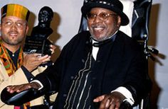 Curtis Mayfield was paralyzed from the neck down after lighting equipment fell on him during a live performance at Wingate Field in Flatbush, Brooklyn, New York on August 13, 1990.  He continued his career as a recording artist, releasing his final album New World Order in 1997. Mayfield won a Grammy Legend Award in 1994 and a Grammy Lifetime Achievement Award in 1995, and was a double inductee into the Rock and Roll Hall of Fame, as a member of the Impressions in 1991, and again in 1999 as…
